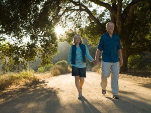 Elderly couple walking and holding hands